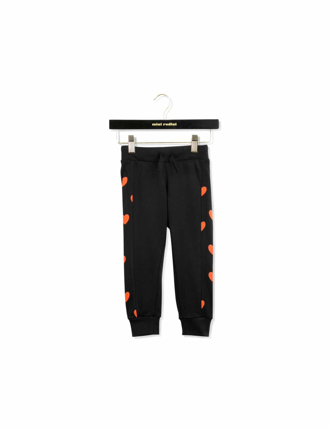 Black sweatpants with printed red hearts along the sides and soft cuffs at leg endings and waist