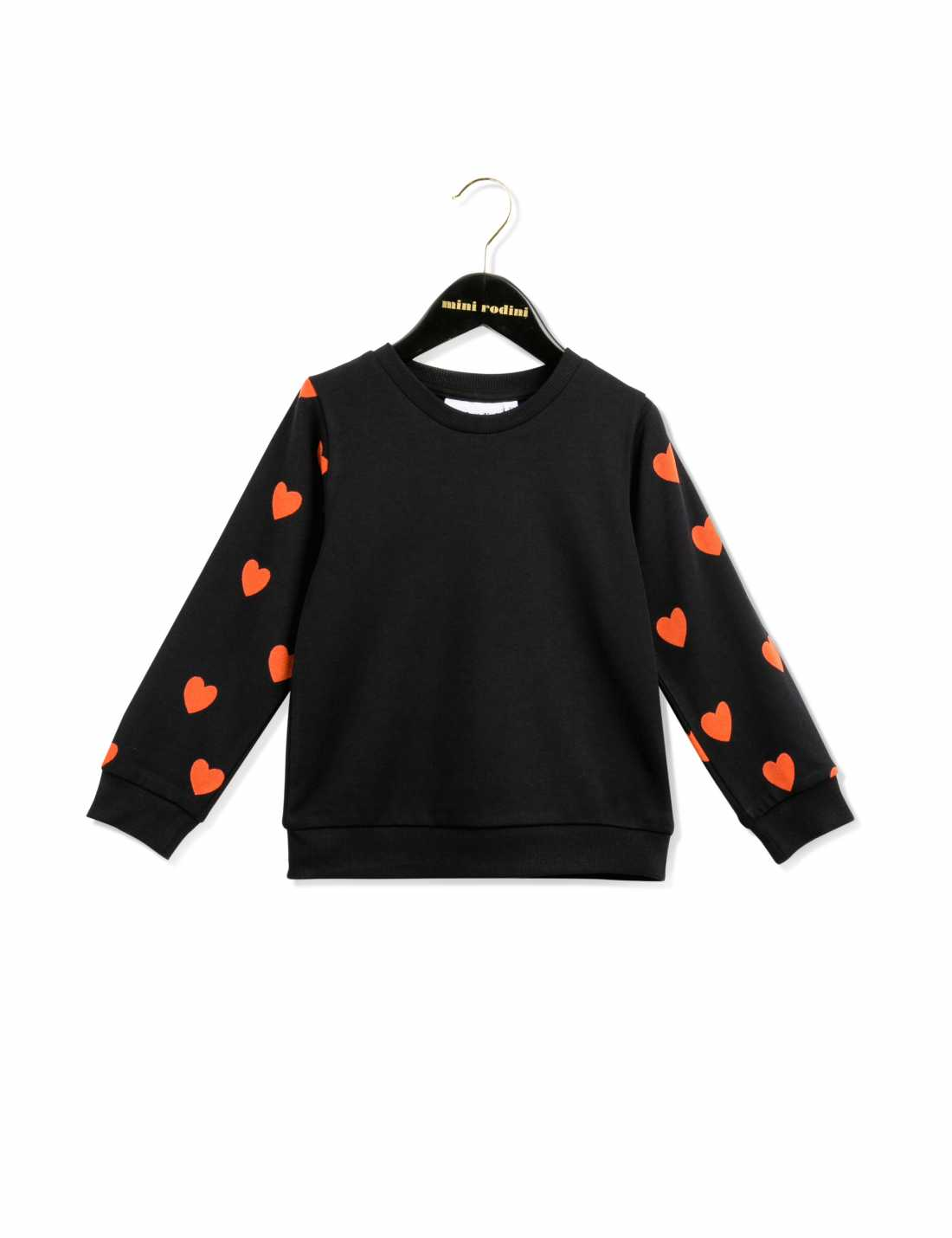 Black sweatshirt with red hearts printed all over the sleeves.